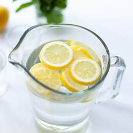 lemon water in pitcher, lemon water